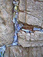 written prayers inserted at the Wailing Wall